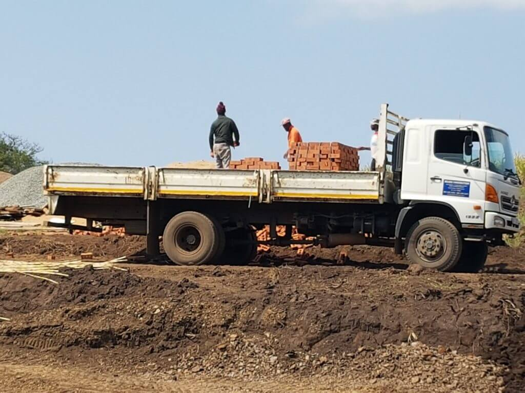 For transport of building materials, sand and stone,  topsoil and transport of material from site clearing
